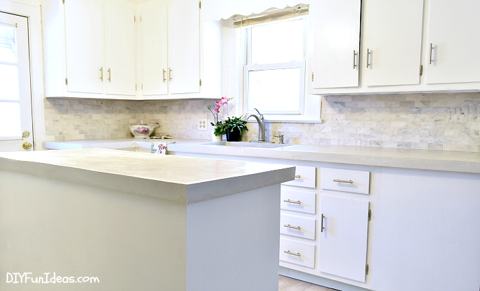 How to make diy cast in place white concrete countertops for Building kitchen cabinets in place